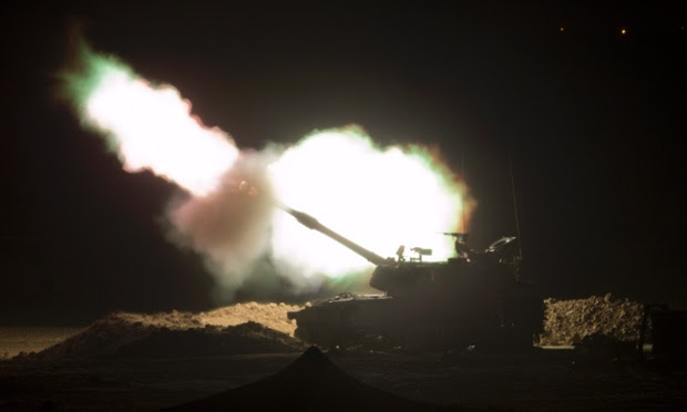 An Israeli 155mm artillery cannon fires from a base in southern Israel into the Gaza Strip.