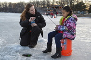 Woman and child ice fishing