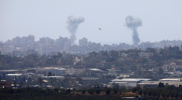 Smoke rises following an Israeli air strike in the Gaza Strip, as seen from the Israeli side of the border between Israel and Gaza.