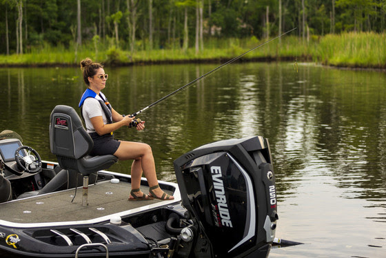 An image of a female angler fishing on a boat.