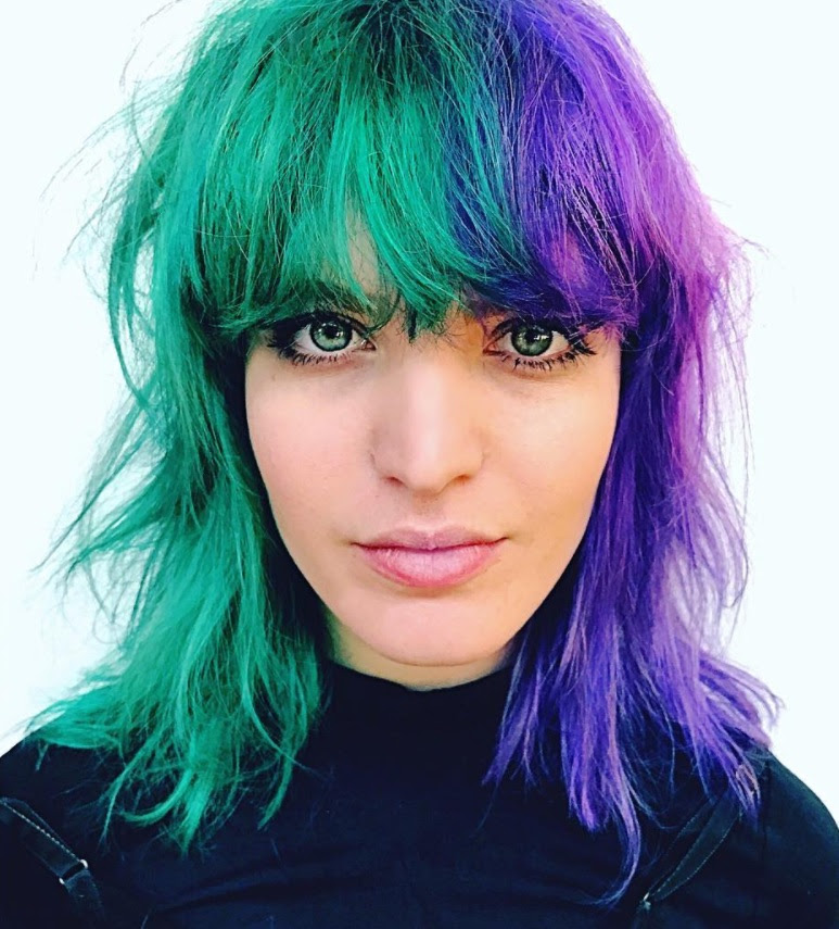 Vibrant hair color green and bright purple
