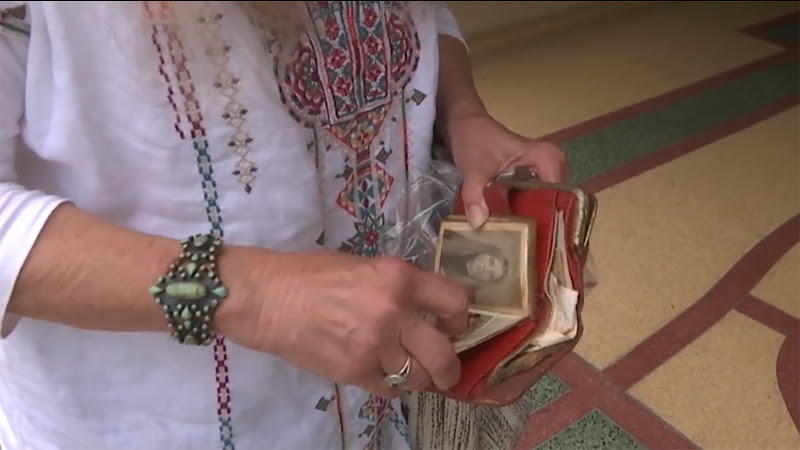 A woman looking through an old wallet