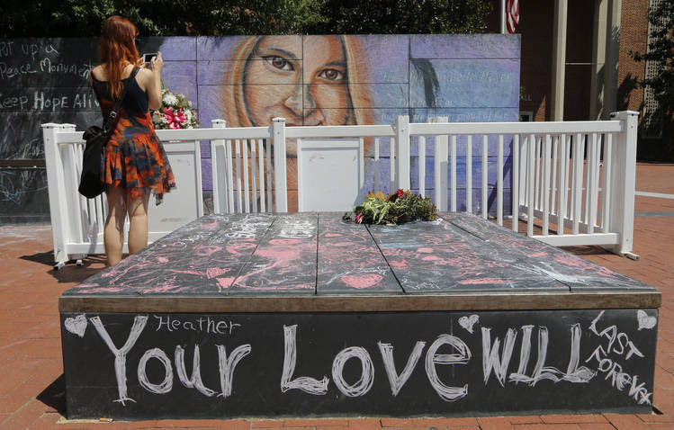A photographer captures a mural of car attack victim Heather Heyer. (Steve Helber/AP)