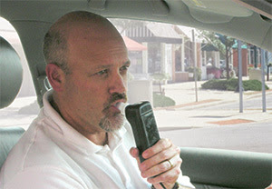 Photo: man using an ignition interlock device