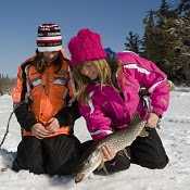 two girls ice fishing