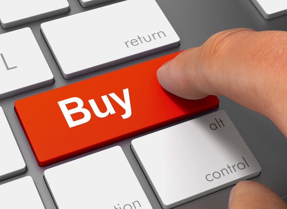 Person pressing a buy button