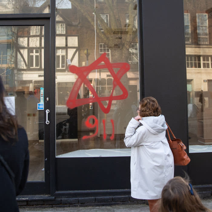 Anti-semitic graffiti in the form of numbers, 9 11, and a Star of David, on a shop window in Belsize Park, North London. credit PA Images