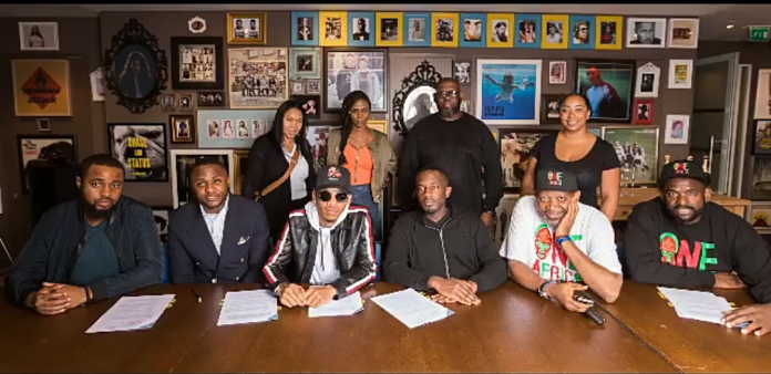 Tekno-during-his-signing-with-UMG-Nigeria.png