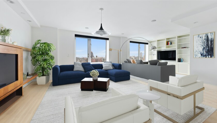 A living room with a TV and scattered couches