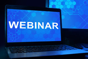 computer with webinar written on the screen