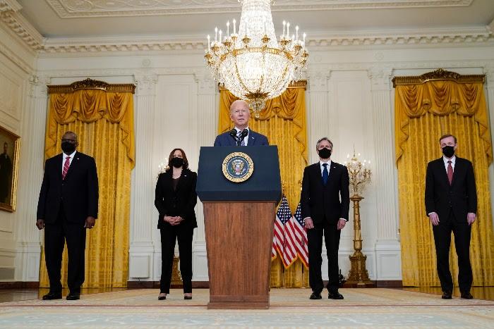 President Joe Biden speaks at the White House. From left, Secretary of Defense Lloyd Austin, Vice President Kamala Harris, Biden, Secretary of State Antony Blinken and White House national security adviser Jake Sullivan.