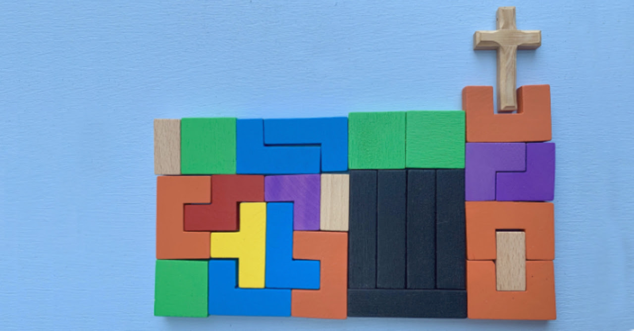 Wooden cross and puzzle blocks