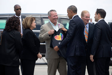 Mayor Buddy Dyer of Orlando greeted President Obama with a #Orlando United T-shirt as he arrived in the city to meet with family members of the victims in Sunday's shooting.