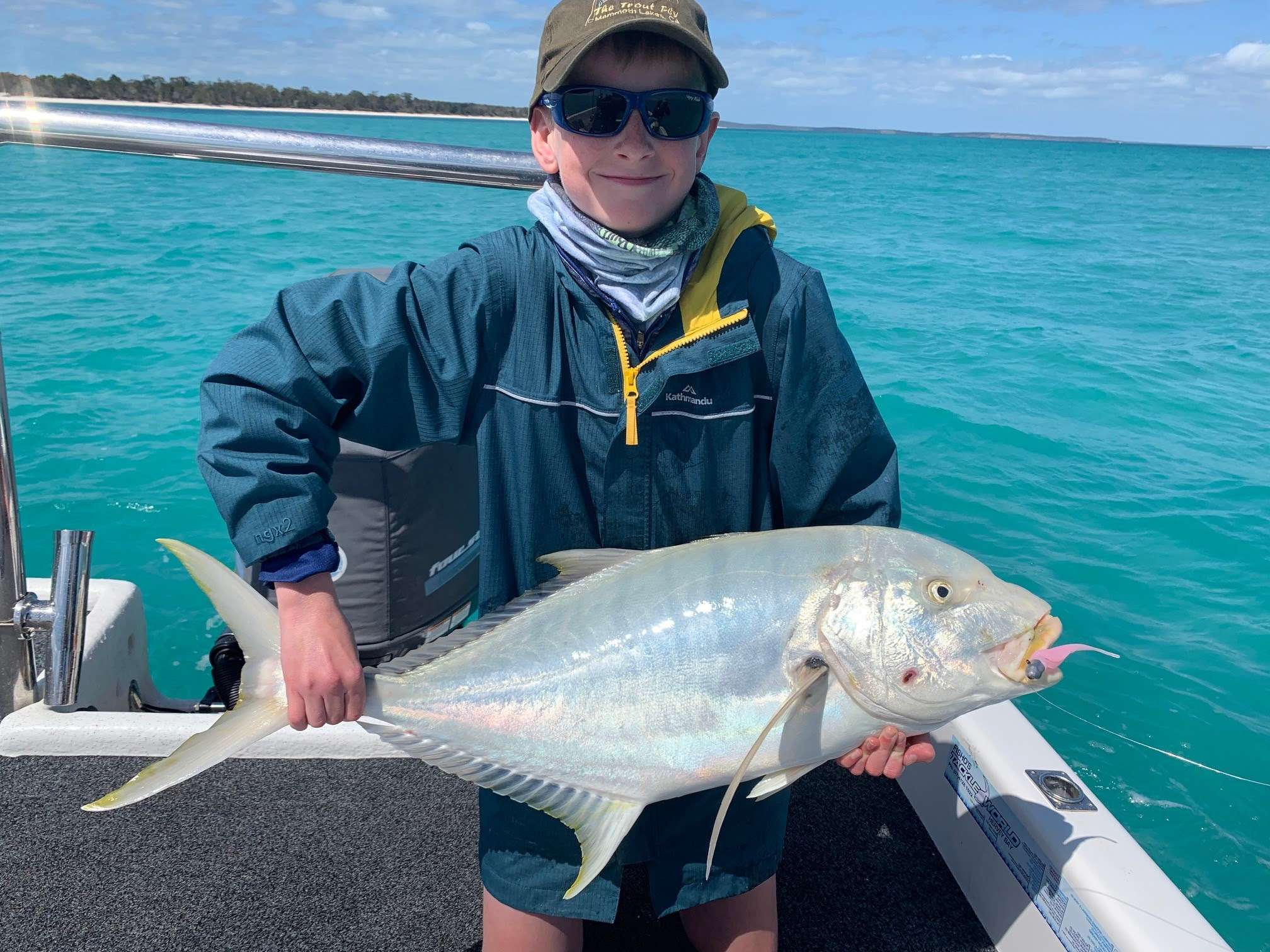 Cooper Holm with a solid golden trevally caught in shallow water.