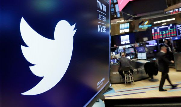 In this Feb. 8, 2018, file photo, the logo for Twitter is displayed above a trading post on the floor of the New York Stock Exchange.  Twitter is imposing new rules, Friday, Oct. 9, 2020,  ahead of the U.S. presidential election, prohibiting people,  including candidates, from claiming an election win before it is called by either state election officials or two authoritative, national news outlets. (AP Photo/Richard Drew, File)  **FILE**