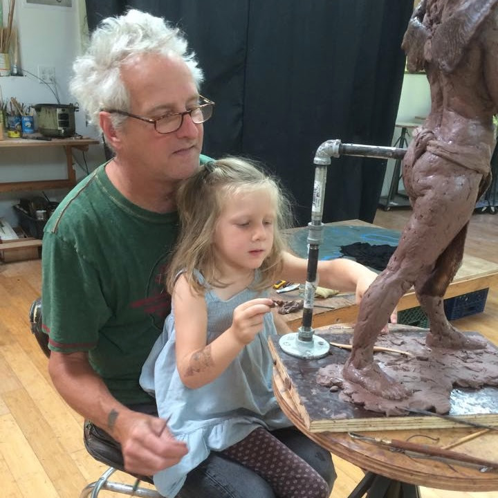 Michael Magrath and his daughter Maggie at work in the Vashon Studio