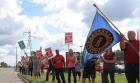 Рабочие GM голосуют за окончание забастовки
