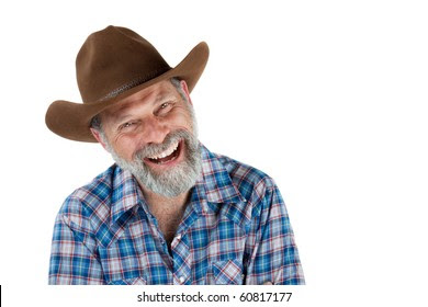 Cheerful portrait of a smiling cowboy