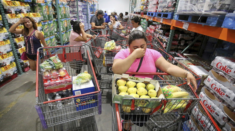 Shoppers wait in line for the arrival of a shipment of water during preparations for the impending arrival of Hurricane Irma in Florida. (Joe Burbank/AP)