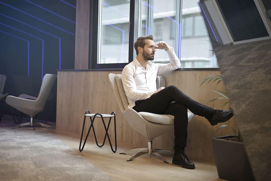 Joel sitting looking in window deep in thought.jpg