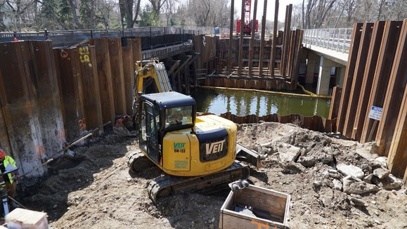 Picture of crews working to excavate the abutment for the north end of the Cedar Lake Channel LRT bridge.