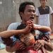 A Cambodian protester carried a wounded worker in Phnom Penh.