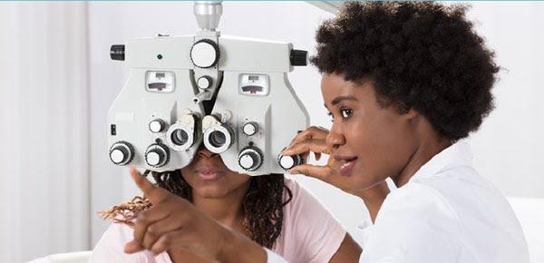 Eye doctor examining patient.