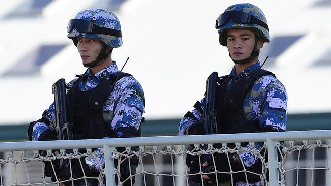 Chinese navy personnel stand guard aboard one of the warships docked at Garden Island in Sydney yesterday. Picture: AAP