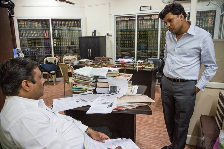 Nitin Mangal, right, at his lawyers' office. Mr. Mangal said he was chained to a hotel bed during one night of a trip with police investigating his case.