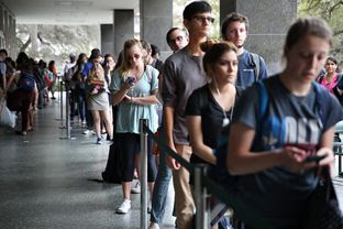 People stand in line to vote for the primaries at the Flawn Academic Center on the University of Texas campus on March 1, 2016.