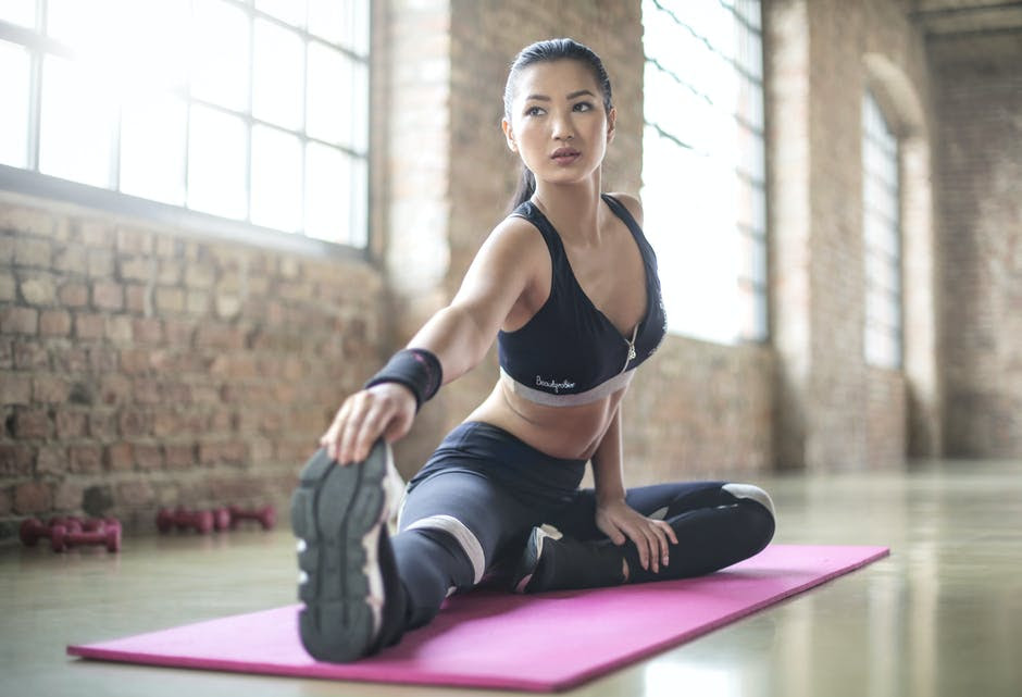 Woman in Black Sports Brassiered and Black Pants Doing             Yoga