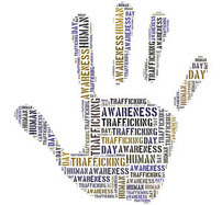 hand with the words human trafficking and awareness written on it