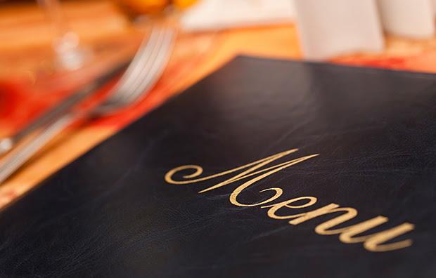 A closeup of the front cover of a food menu.
