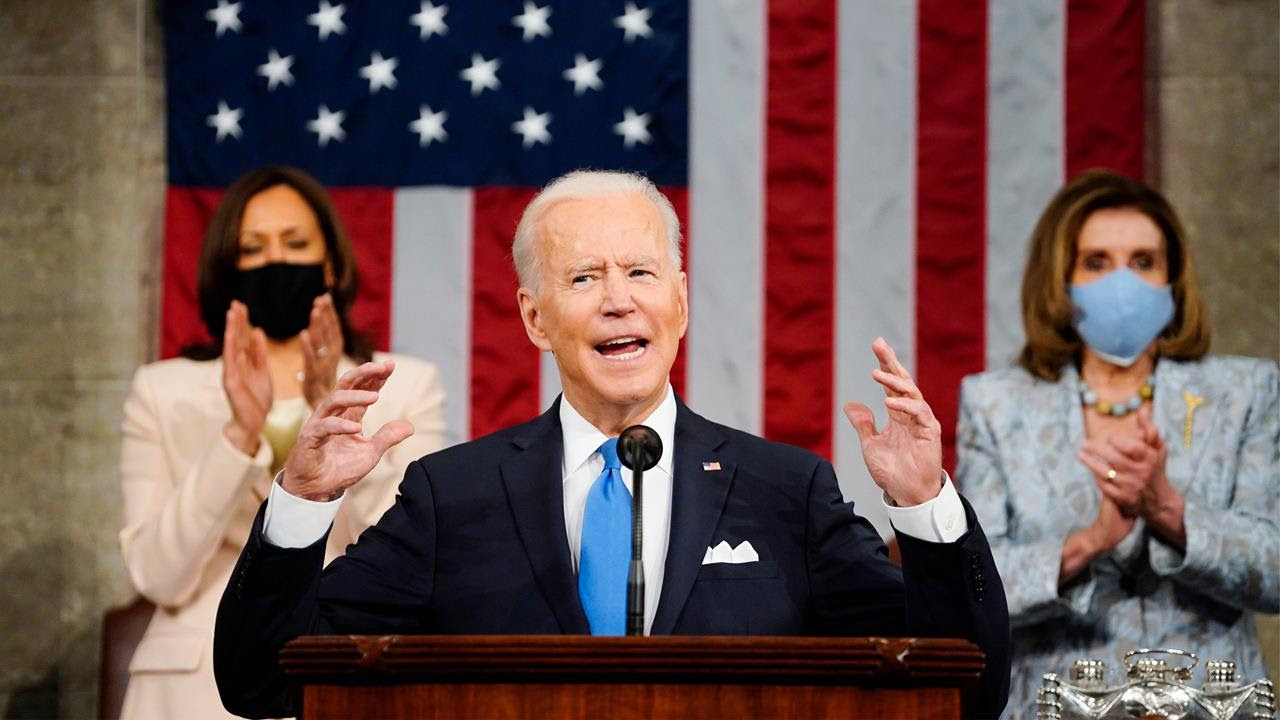 Vice President Kamala Harris and House Speaker Nancy Pelosi stand and applaud as President Joe Biden addresses a joint session of Congress, April 28, 2021.