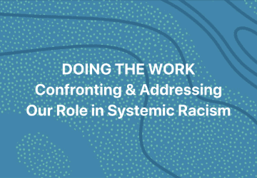 """Caption against blue backdrop with a wave pattern from top left to bottom right with small green air bubbles """"DOING THE WORK Contronting & Addressing Our Role in Systemic Racism""""."""