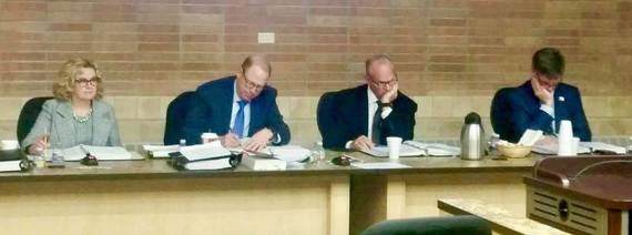 State Superintendent Jillian Balow sit on the dais for a State Loan and Investment Board meeting with the Secretary of State, Governor, and State Treasurer.