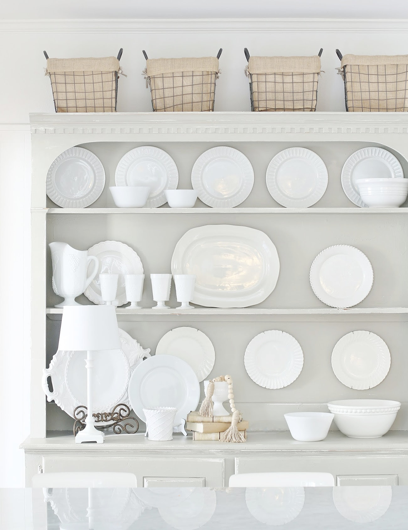 gray kitchen hutch with white dishes and plates