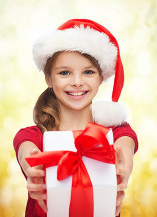 Photo of a young girl holding a present