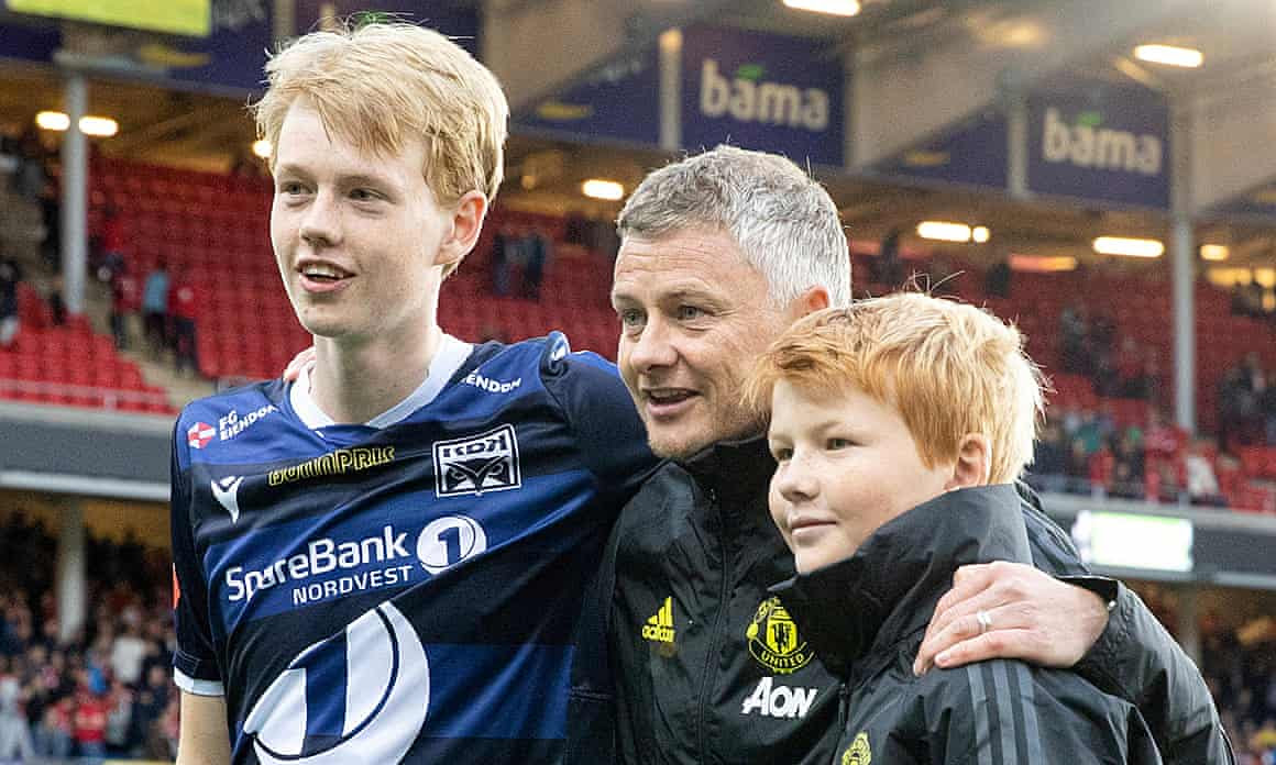Manchester United manager Ole Gunnar Solskjær poses with his sons Noah (left) and Elijah.