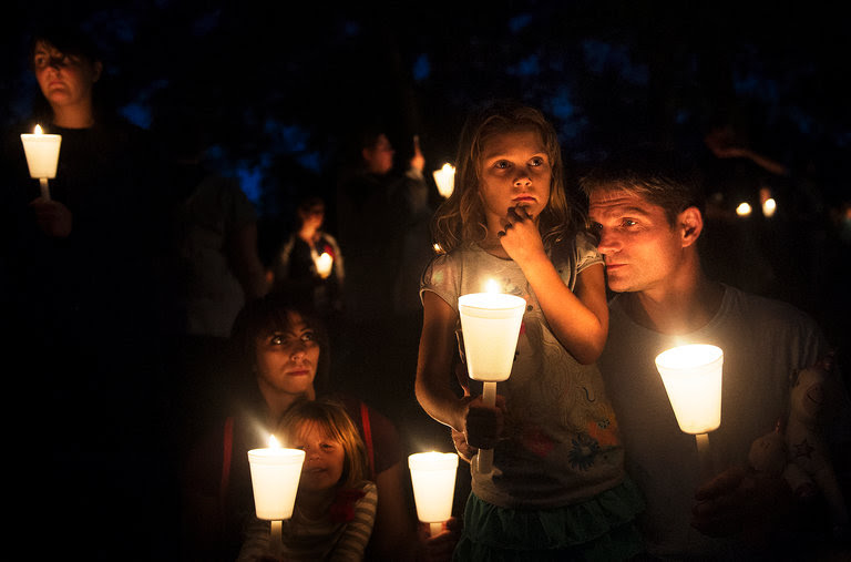 A vigil in Roseburg, Ore., after a gunman killed nine people on a community college campus on Thursday.