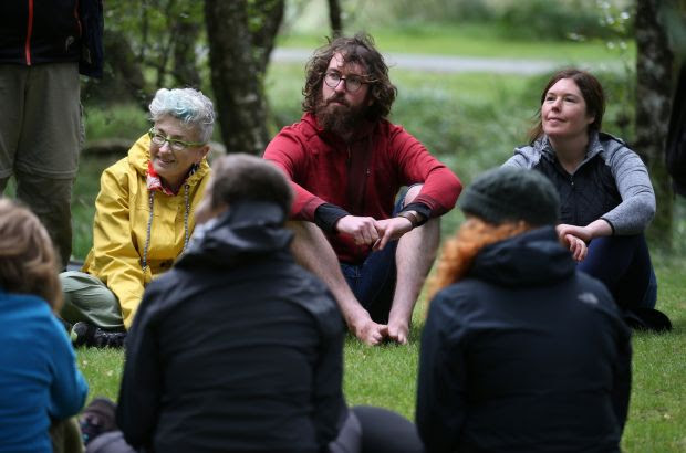 Forest bathing training: Ciaran Thorton (centre) taking part in the course in Glendalough forest, Co Wicklow, led by Shirley Gleeson (right). Photograph: Crispin Rodwell
