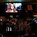 """The """"60 Minutes"""" interview of Stephanie Clifford, known professionally as Stormy Daniels, on a screen at the Hi-Life bar in Manhattan on Sunday."""