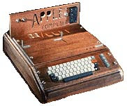 Photo of Apple 1 with keyboard in wood case.