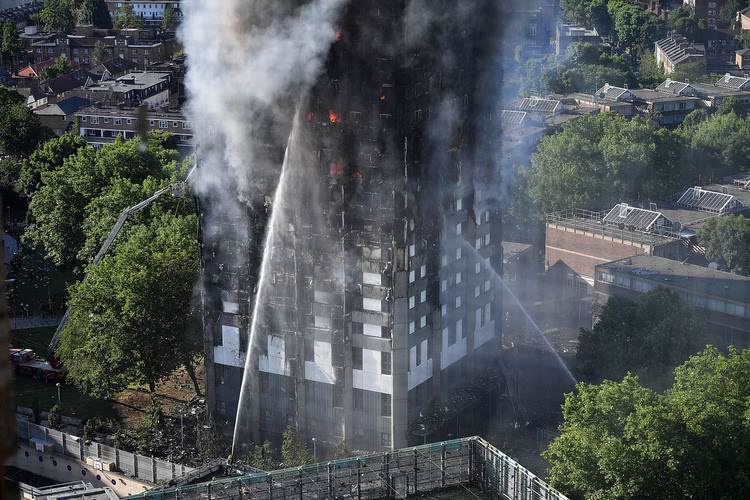 Firefighters tackle a huge fire at Grenfell Tower in Latimer Road, West London, on June 14. (Leon Neal/Getty Images)</p>