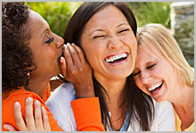 Group of 3 women laughing.