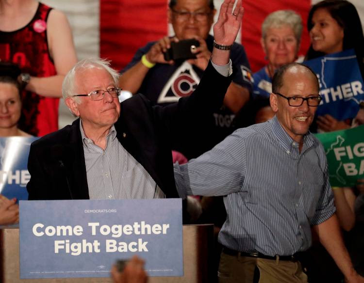 Sen. Bernie Sanders, I-Vt, left, and Democratic National Committee chairman Tom Perez, wave during a DNC rally. (Matt York/AP)