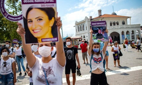 TURKEY-POLITICS-RIGHTS-WOMEN-DEMO<br>Demonstrators wearing protective face masks, hold portraits of women and placards reading 'we are not quiet', during a protest called by KCDP (We Will Stop Femicides Platform - Kadin Cinayetlerini Durduracagiz Platformu) and Womens Assemblies, for a better implementation of the Istanbul Convention and the Turkish Law 6284 for protection of the family and prevention of violence against women, in Istanbul, Turkey, on July 19, 2020. (Photo by Yasin AKGUL / AFP) (Photo by YASIN AKGUL/AFP via Getty Images)