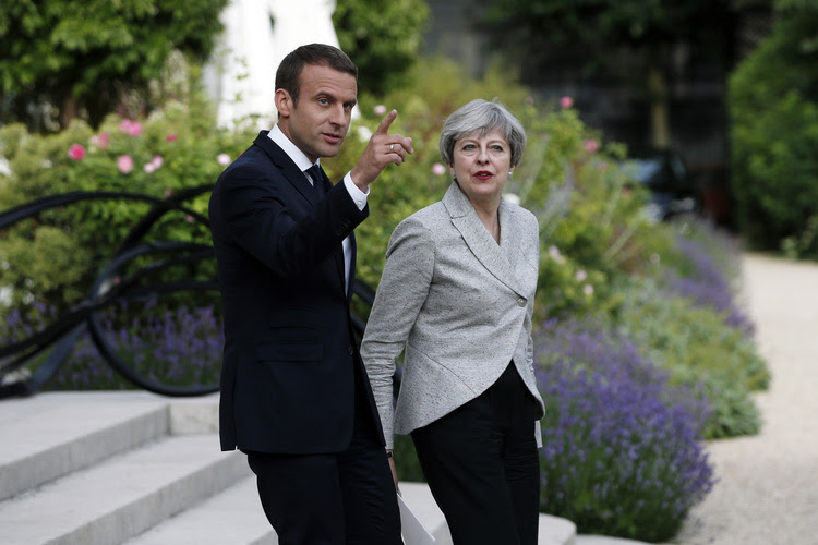 Emmanuel Macron and Theresa May arrive for a joint press conference in Paris on June 13. (Thibault Camus/AP)</p>