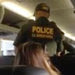In an image from a recording, a Border Patrol officer checking the identification last month of travelers on a Greyhound bus in Fort Lauderdale, Fla. The officers escorted a woman off the bus.