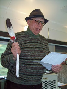 Kent Bowman, one of the key organizers behind the tour, is seen with the talking feather.